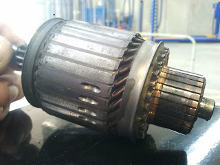 a starter motor armature showing the commutator