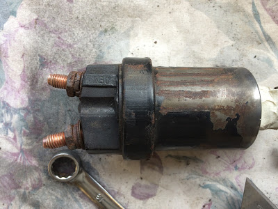 a starter solenoid detached from the main starter assembly